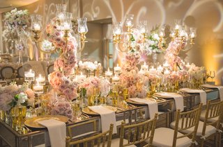 wedding-reception-with-mirrored-table-gold-chairs-lilac-pink-roses-on-gilt-candelabra