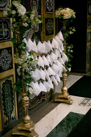 wedding-ceremony-at-greek-orthodox-church-with-rows-of-white-handkerchiefs-on-gold-stand-clothespin