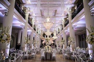 wedding-reception-at-the-corinthian-in-houston-white-columns-purple-lighting-white-flowers-modern