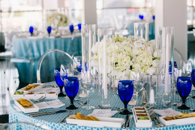 Blue Spotted Table Linens and White Centerpieces