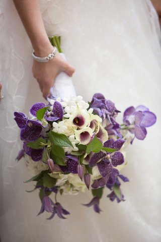 calla-lily-stephanotis-blossom-purple-orchid-flowers-white-roses-bride-bouquet-wedding-flowers