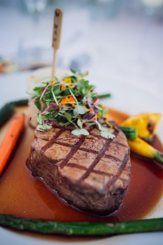 sit-down-dinner-serves-filet-mignon-plate-with-vegetables