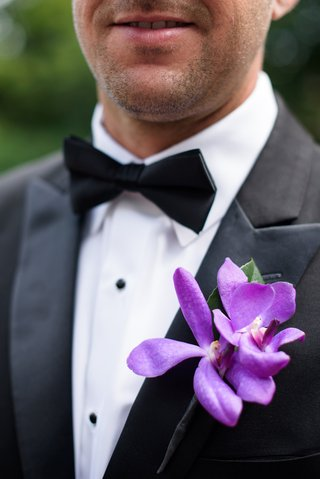 groomsmans-boutonniere-made-with-two-purple-orchids