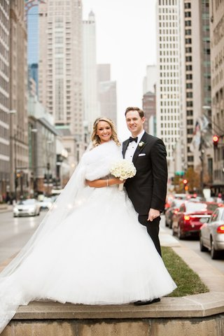 bride-in-monique-lhuillier-ball-gown-and-fur-shrug-groom-in-hugo-boss-downtown-chicago-winter