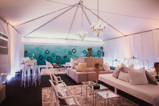 tented-reception-area-with-lounge-seats-succulent-wreaths