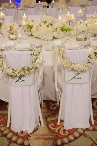 mr-and-mrs-chairs-with-white-rose-decorations