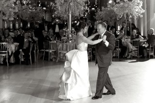 black-and-white-photo-of-bride-in-a-carolina-herrera-gown-dancing-with-father