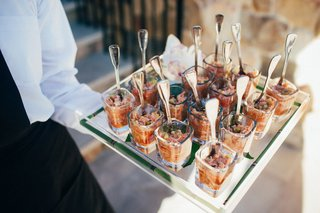 server-holds-crab-appetizers-for-cocktail-hour