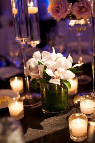 candle-votives-surrounding-white-orchid-arrangement