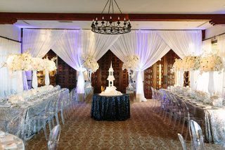 cathedral-cake-placed-on-table-in-center-of-the-room-sequined-tablecloths