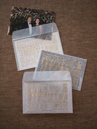 wedding-reception-favors-photo-booth-photobooth-sheer-sleeves-gold-foil-lettering-with-guest-picture