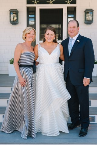 bride-in-striped-hayley-paige-wedding-dress-mother-of-the-bride-in-black-and-white-striped-dress