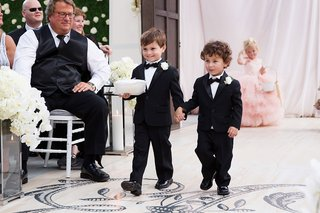 wedding-ceremony-wood-aisle-runner-monogram-two-ring-bearers-tuxedos-bow-ties-boutonnieres