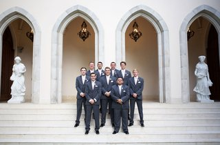 wedding-at-chateau-venue-groomsmen-in-grey-suits-and-pink-ties