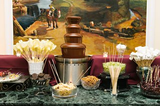 chocolate-fountain-with-oreo-cookies-pretzels-grapes-marshmallows-cherries-pineapple-fruit