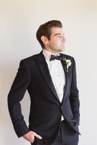 groom-in-ralph-lauren-purple-label-suit-with-hands-in-pocket-grooms-portrait-in-profile