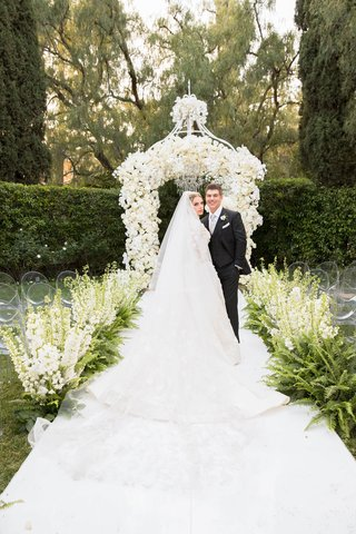 bride-in-marchesa-couture-wedding-dress-groom-in-suit-at-beverly-hills-hotel-wedding-outdoor-garden