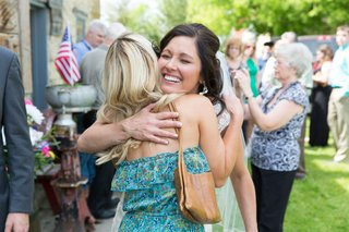shelly-bartels-hugging-guest-at-wedding-cocktail-hour