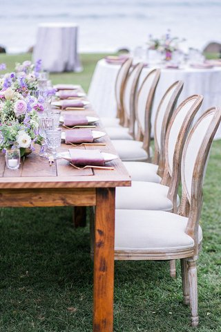 wedding-reception-destination-wedding-hawaii-french-upholstered-chairs-low-purple-flowers-gold-forks