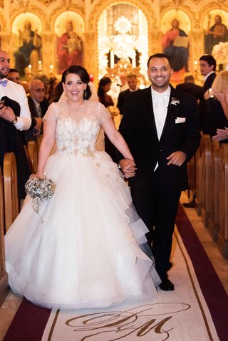 bride-in-lazaro-wedding-dress-at-ceremony-aisle-with-custom-original-runner-company-aisle-runner