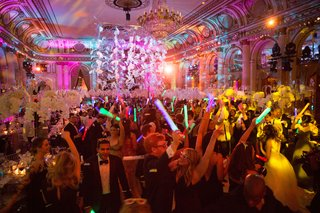 guests-on-dance-floor-at-wedding-reception-the-plaza-hotel-in-new-york-city-glow-sticks-and-lighting