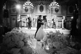 black-and-white-photo-of-newlyweds-first-dance-bride-in-monique-lhuillier-gown
