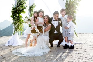 bride-in-monique-lhuillier-and-groom-in-tux-smiling-malibu-rocky-oaks-cute-flower-girls