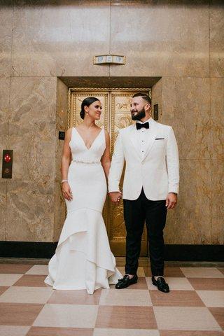 wedding-portrait-for-reception-new-tuxedo-for-groom-v-neck-dress-for-bride-hair-low-bun