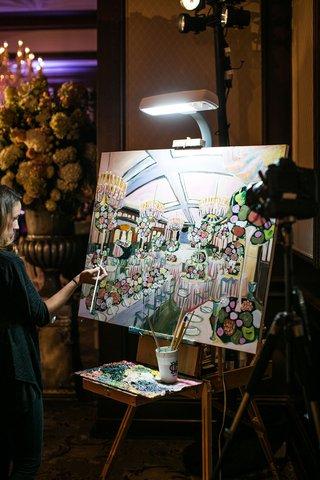 artist-painting-reception-venue-chandeliers-tall-centerpieces-flower-runner-paintbrush-live-event