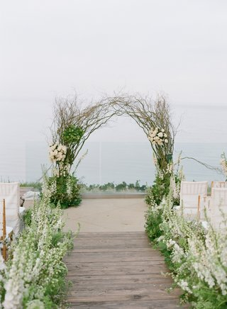 wedding-arch-made-with-branches-for-beach-wedding