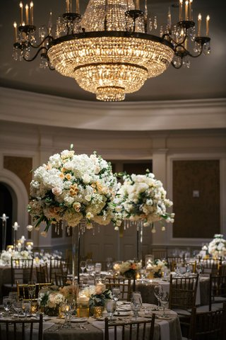 tall-centerpieces-white-and-peach-blush-flowers-round-arrangement-crystal-chandelier-round-tables