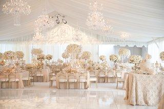 neutral-tent-wedding-reception-white-tall-flower-centerpieces-linens-dance-floor-chandeliers
