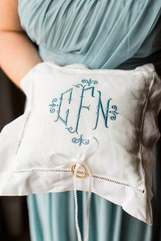 white-ring-pillow-with-blue-embroidered-monogram