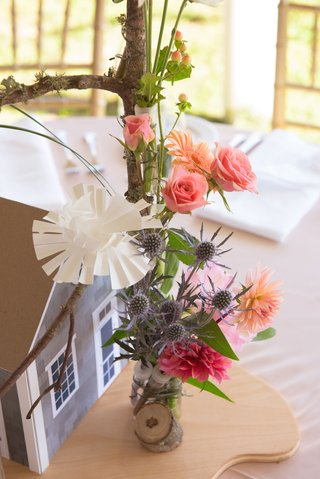 rustic-wedding-decoration-centerpiece-branch-with-thistle-paper-flowers-pink-roses-orange-daisy