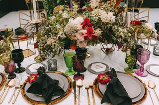 wedding-reception-gold-charger-plate-and-flatware-color-goblets-glassware-fall-centerpiece-candles