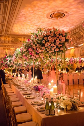 wedding-reception-at-the-plaza-hotel-with-tall-pink-and-greenery-centerpieces-flower-runner-candles