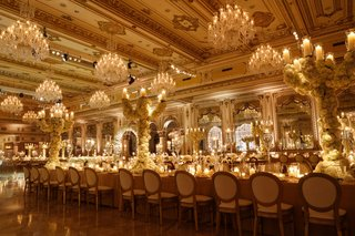 wedding-reception-in-luxury-ballroom-the-mar-a-lago-club-tall-centerpiece-candelabra-covered-roses