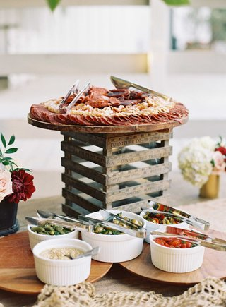 wedding-cocktail-hour-food-display-on-ruler-crate-with-meats-dips-and-peppers