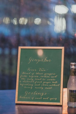 wedding-reception-cocktail-hour-green-menu-in-gold-frame-gilt-calligraphy-ginger-beer