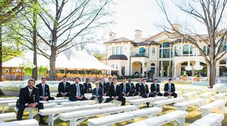 groom-with-friends-in-blue-ties-at-backyard-ceremony