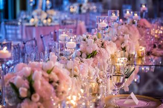 wedding-reception-table-with-violet-lighting-mirror-top-white-tulip-white-pink-rose-candles