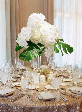destination-wedding-modern-beach-glam-reception-with-sequin-linen-orchid-hydrangea-philodendron