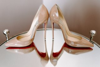 nude-wedding-heels-christian-louboutin-red-sole-bottoms-on-mirror-table-wedding-patent-leather