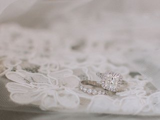 wedding-ring-on-piece-of-lace-diamond-wedding-ring-and-band-veil-lace