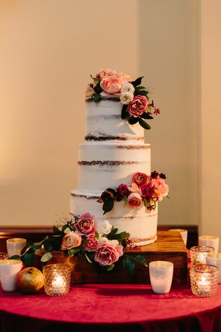 semi-naked-cake-lightly-frosted-three-tiered-cake-with-fresh-flowers