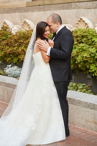bride-in-strapless-vera-wang-wedding-dress-long-veil-hair-down-groom-in-tuxedo-suit-washington-dc
