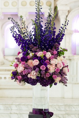 clear-vase-topped-with-purple-and-pink-flowers