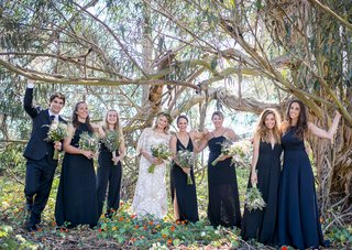 bride-bridesmaids-bridesman-male-bridesmaid-navy-blue-dresses-tuxedo-wildflower-bouquets
