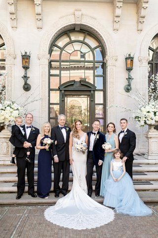 bride-in-pnina-tornai-wedding-dress-with-groom-bridal-party-and-parents