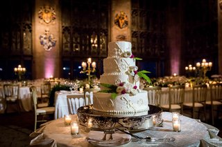four-tier-wedding-cake-with-classic-design-fresh-flowers-and-ferns